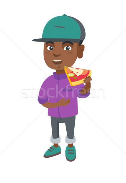 African-american boy eating tasty pizza. Stock photo © RAStudio