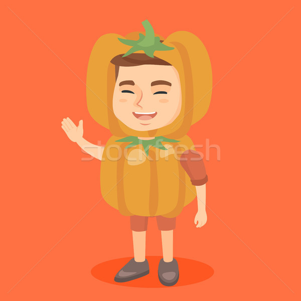 Caucasian boy in a halloween pumpkin costume. Stock photo © RAStudio