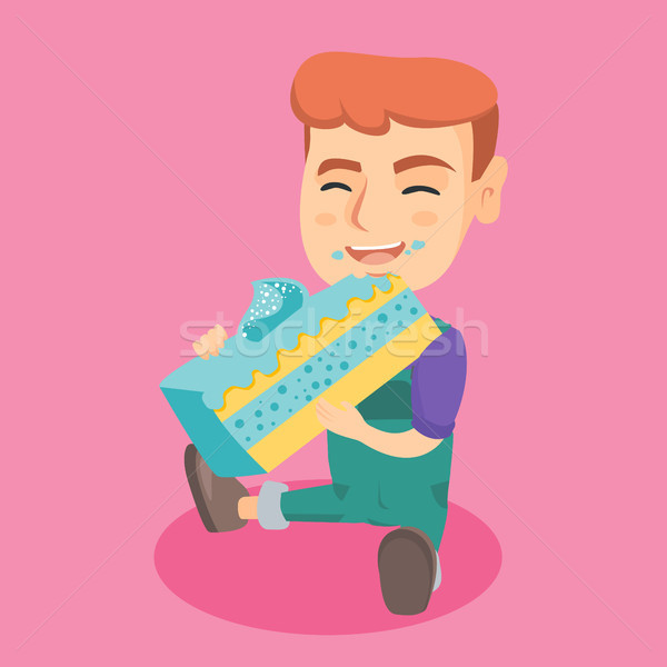 Little caucasian happy boy eating a piece of cake. Stock photo © RAStudio