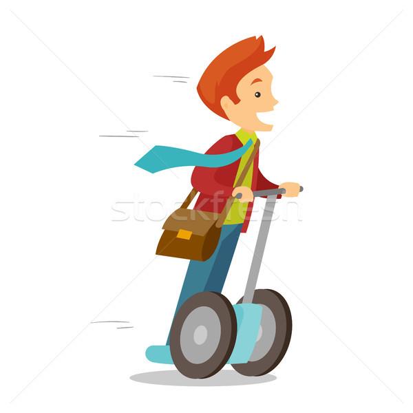 Caucasian white man riding on electric scooter. Stock photo © RAStudio