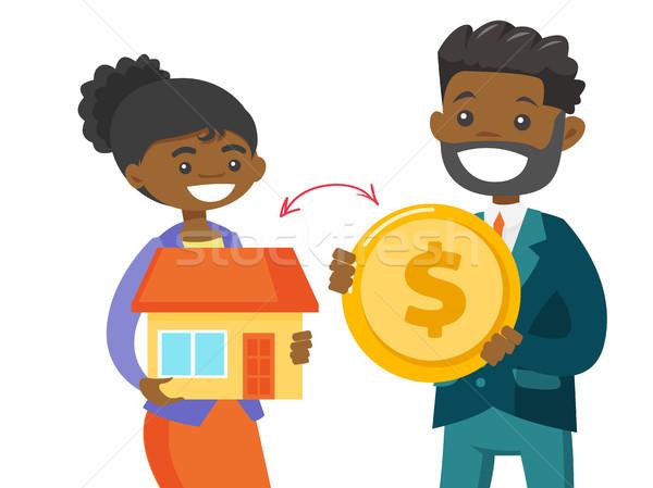 Emlâkçı ev sikke müşteri dolar Stok fotoğraf © RAStudio