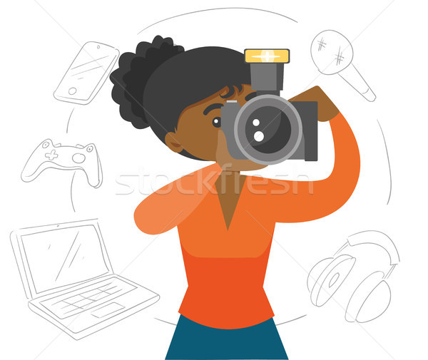 Black woman making a photo with modern camera Stock photo © RAStudio