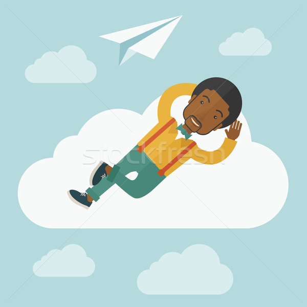 Black man lying on a cloud with paper plane. Stock photo © RAStudio