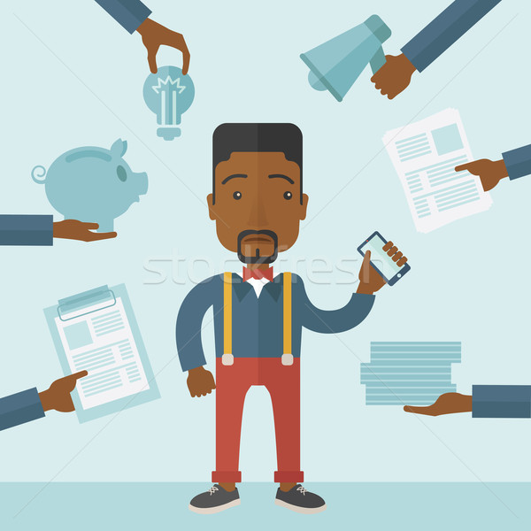 Black man with smartphone in hand. Stock photo © RAStudio