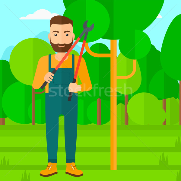 Farmer with pruner in garden. Stock photo © RAStudio