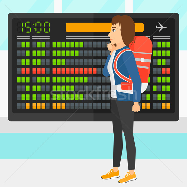 Mulher olhando programar conselho aeroporto vetor Foto stock © RAStudio
