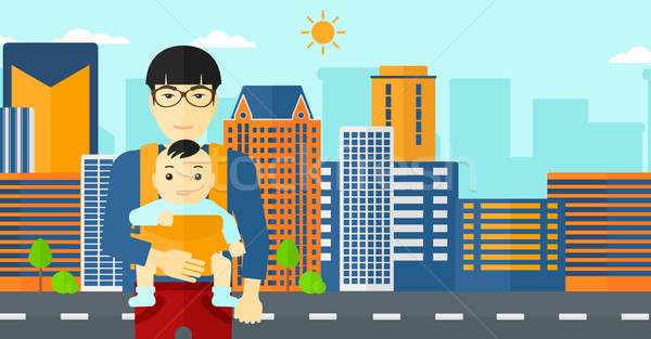 Man holding baby in sling. Stock photo © RAStudio