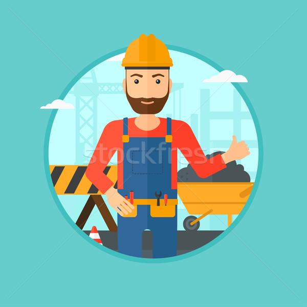 Сток-фото: строителя · большой · палец · руки · вверх · шлема · строительная · площадка