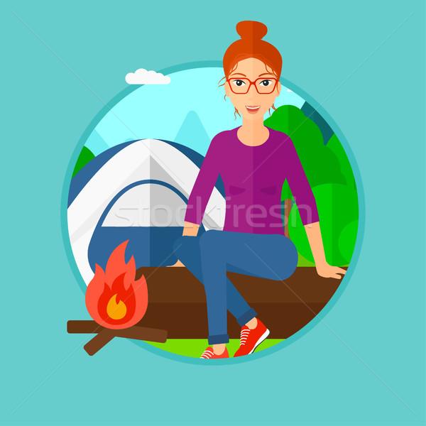 Woman sitting on log in the camping. Stock photo © RAStudio