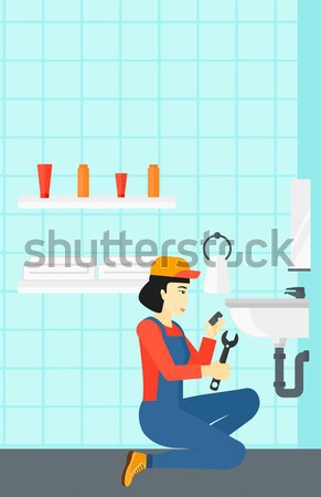 Woman repairing sink. Stock photo © RAStudio