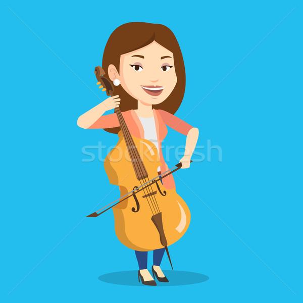Mulher jogar violoncelo jovem feliz caucasiano Foto stock © RAStudio