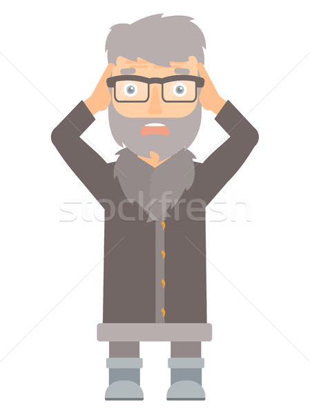 Stressful north man clutching his head. Stock photo © RAStudio