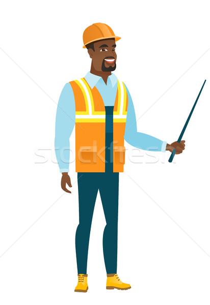 African-american builder holding pointer stick. Stock photo © RAStudio