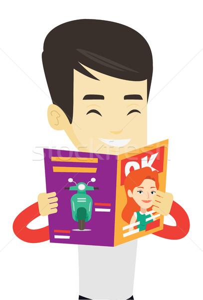 человека чтение журнала азиатских молодым человеком Постоянный Сток-фото © RAStudio