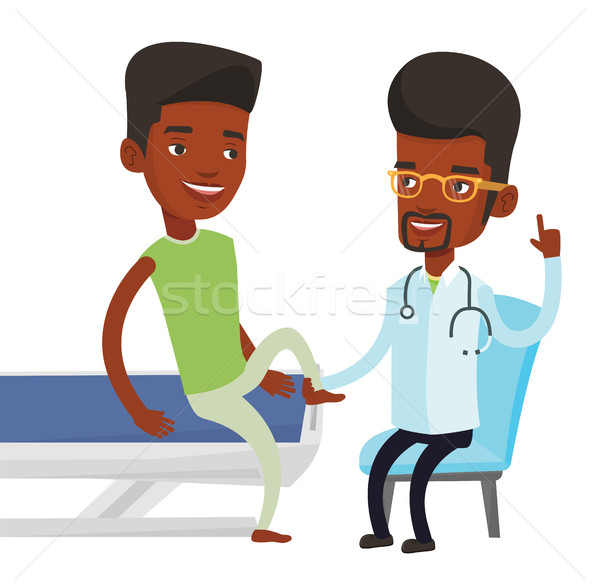 Gym doctor checking ankle of a patient. Stock photo © RAStudio