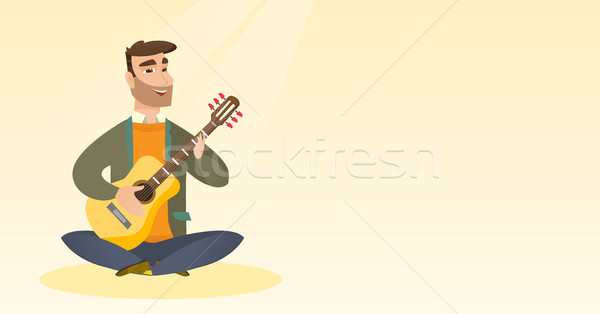 Man playing the acoustic guitar. Stock photo © RAStudio