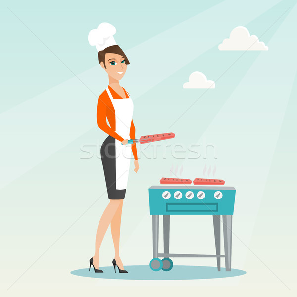 Vrouw koken biefstuk barbecue kaukasisch gas Stockfoto © RAStudio