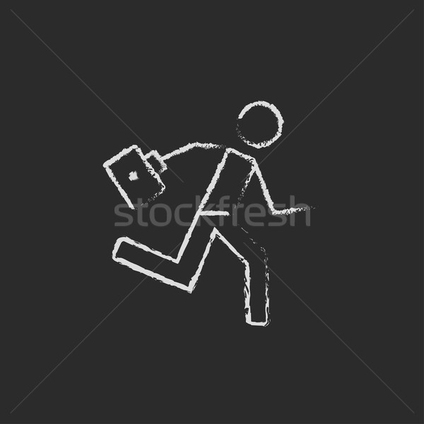 Paramedic running with first aid kit icon drawn in chalk. Stock photo © RAStudio