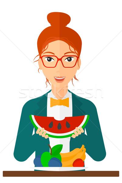 ストックフォト: 女性 · 食べ · スイカ · 興奮した · 立って · 表