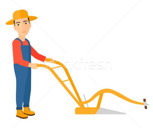 Farmer with plough. Stock photo © RAStudio