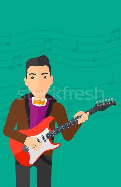 Músico jogar guitarra elétrica homem luz verde notas musicais Foto stock © RAStudio