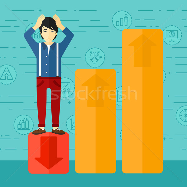Businessman standing on low graph. Stock photo © RAStudio