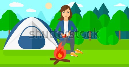 Woman kindling fire. Stock photo © RAStudio