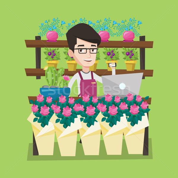 花屋 花屋 小さな 笑みを浮かべて 電話 ノートパソコン ストックフォト © RAStudio