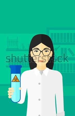Tudós kémcső ázsiai női tart fiatal Stock fotó © RAStudio