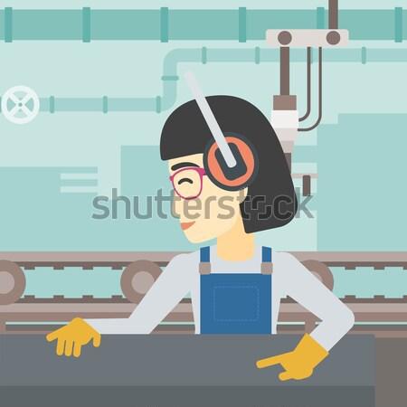 Homme travail métal presse machine asian Photo stock © RAStudio