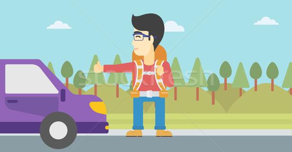 Young man hitchhiking vector illustration. Stock photo © RAStudio