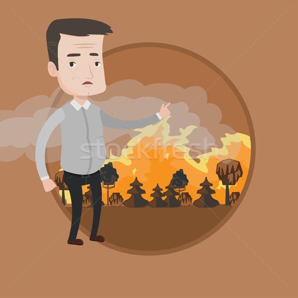 Hombre pie incendios forestales frustrado grande senalando Foto stock © RAStudio