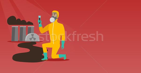 Uomo maschera antigas radiazione suit giovani Foto d'archivio © RAStudio