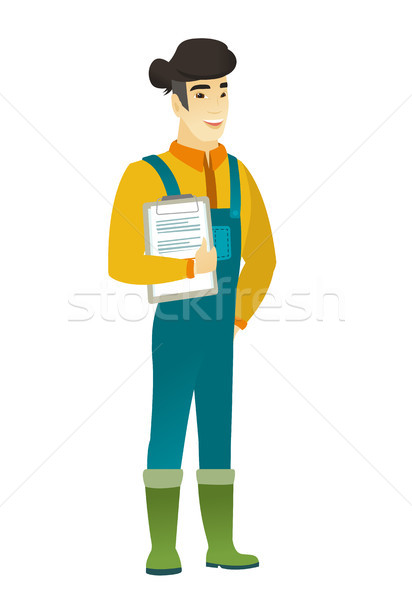 Farmer holding clipboard with papers. Stock photo © RAStudio