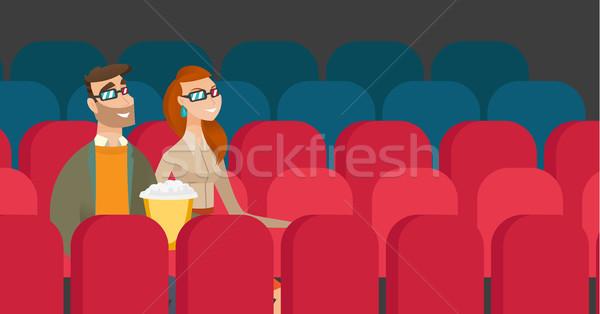 Caucasian couple watching 3D movie in the theatre. Stock photo © RAStudio