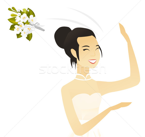 Young asian bride tossing a bouquet of flowers. Stock photo © RAStudio