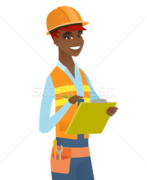 Young african building inspector with clipboard. Stock photo © RAStudio