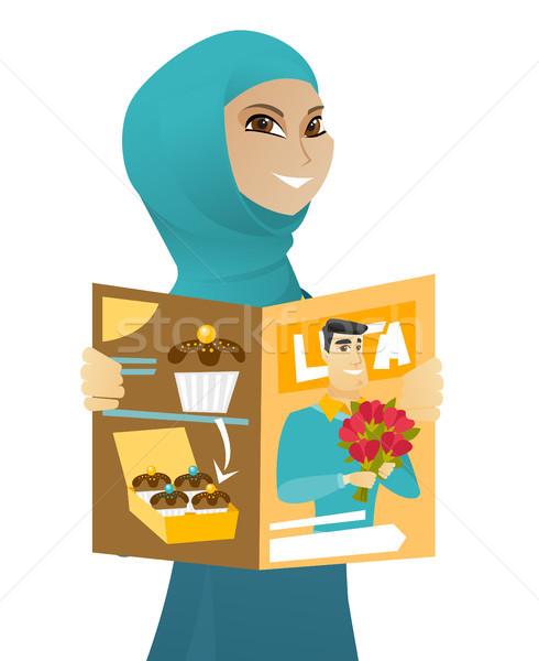 молодые мусульманских деловой женщины чтение журнала успешный Сток-фото © RAStudio