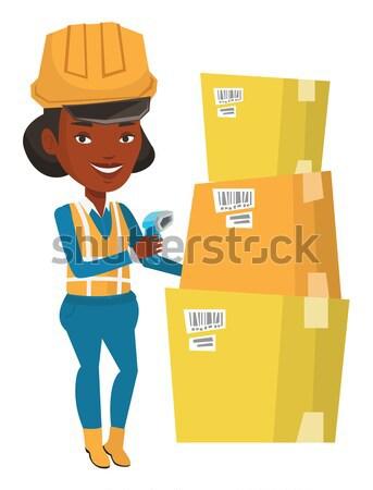 Entrepôt travailleur Barcode boîte africaine scanner Photo stock © RAStudio