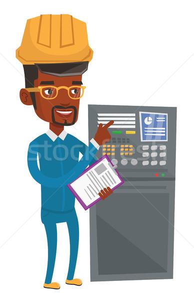 Mérnök áll irányítópanel afrikai férfi dolgozik Stock fotó © RAStudio