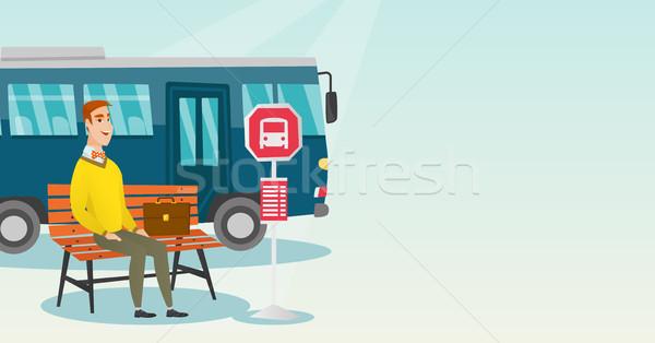 Caucasiano homem espera ônibus parada de ônibus empresário Foto stock © RAStudio