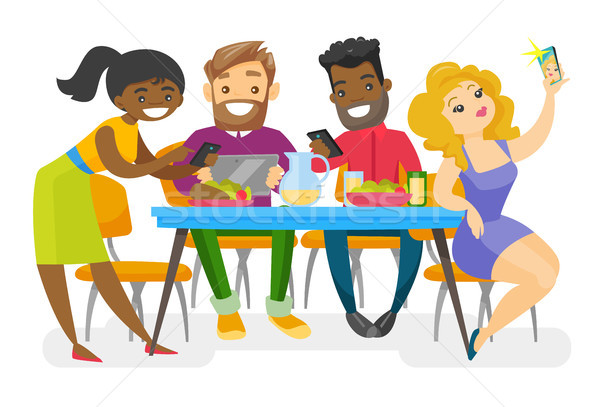 Young multiethnic friends hanging out together. Stock photo © RAStudio
