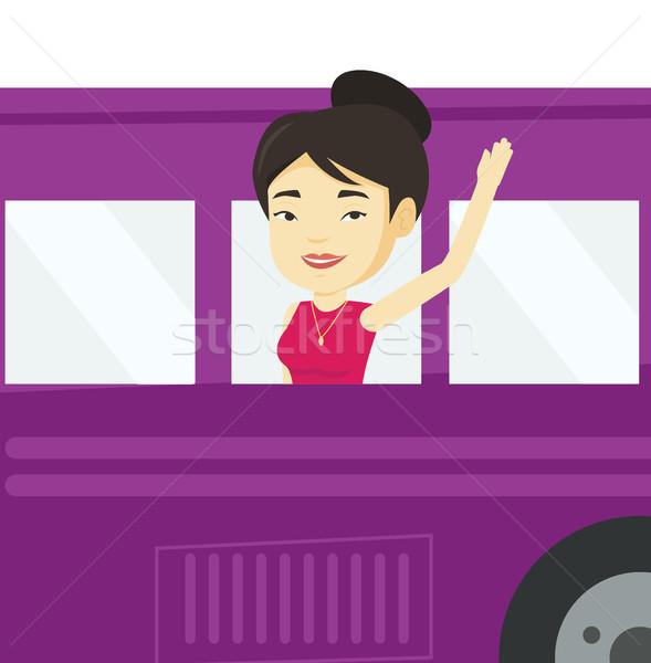 Woman waving hand from bus window. Stock photo © RAStudio