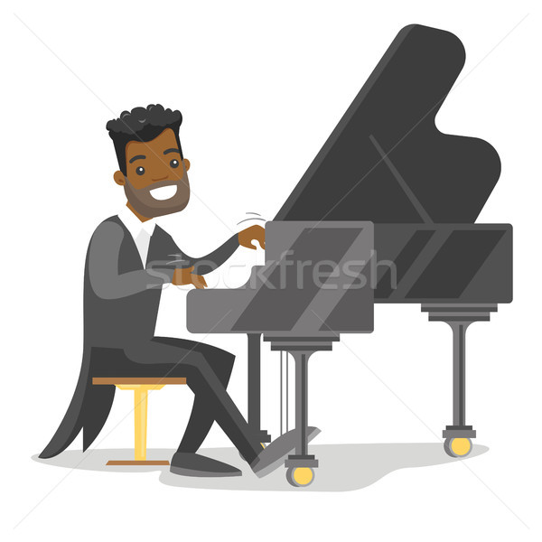 Jonge man spelen piano muzikant pianist Stockfoto © RAStudio