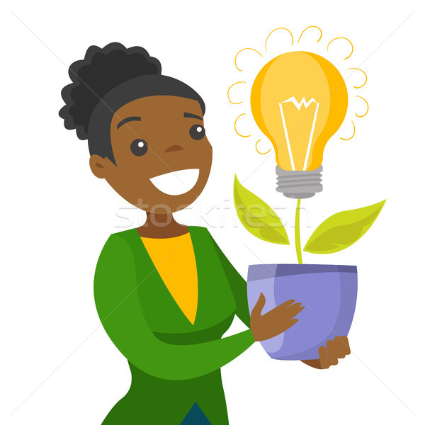 A businesswoman with a lightbulb as a symbol of business idea. Stock photo © RAStudio