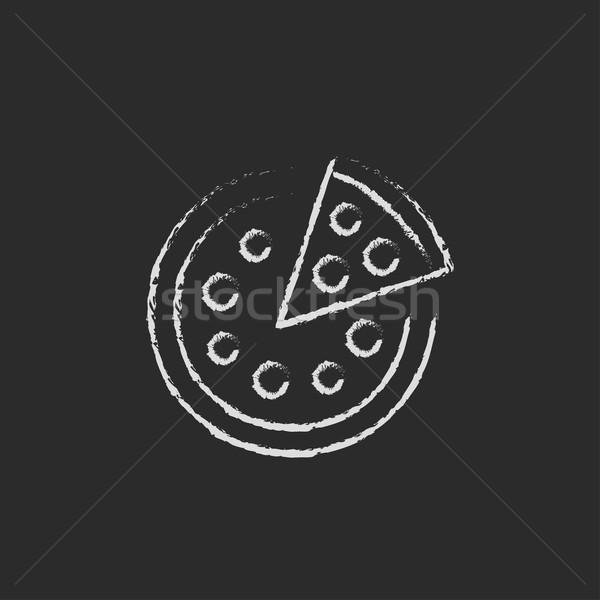 Whole pizza with a slice icon drawn in chalk. Stock photo © RAStudio