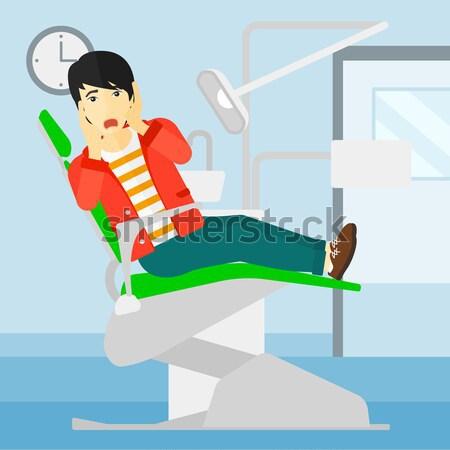 Przestraszony pacjenta stomatologicznych krzesło posiedzenia wektora Zdjęcia stock © RAStudio