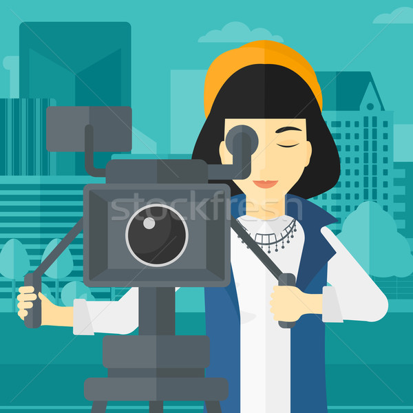 Camerawoman with movie camera on a tripod. Stock photo © RAStudio