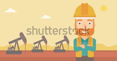 Olajmunkás férfi sisak áll karok olaj Stock fotó © RAStudio
