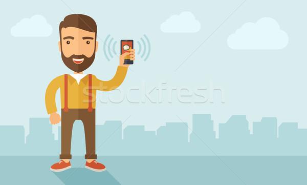 Man holding smartphone. Stock photo © RAStudio